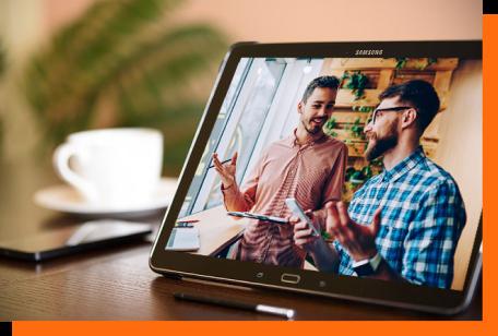 two men discussing markting on laptop screen