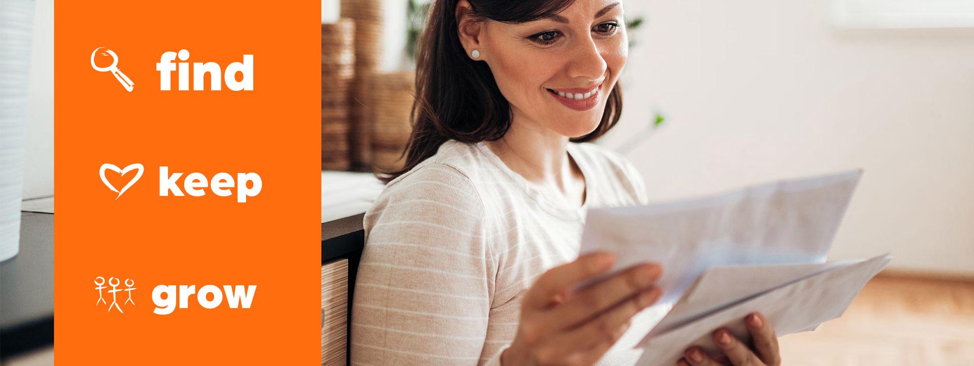 woman reading direct marketing envelopes