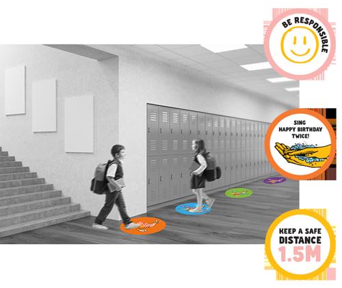 students walking over decals on school hallway floor